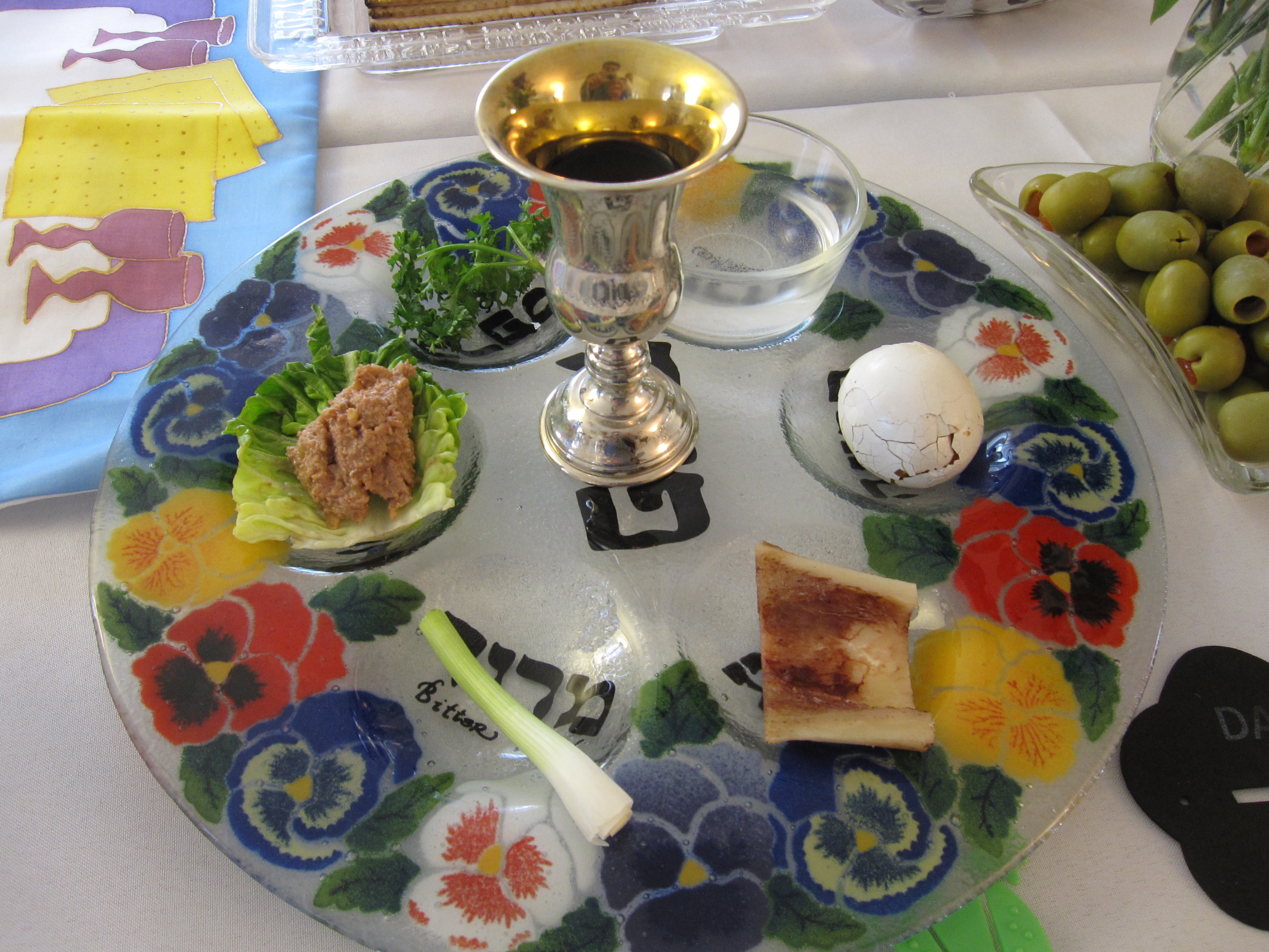 Symbolic foods The six traditional items on the Seder Plate are as follows: Maror and Chazeret — Bitter herbs symbolizing the bitterness and harshness of the slavery the Hebrews endured in Egypt.